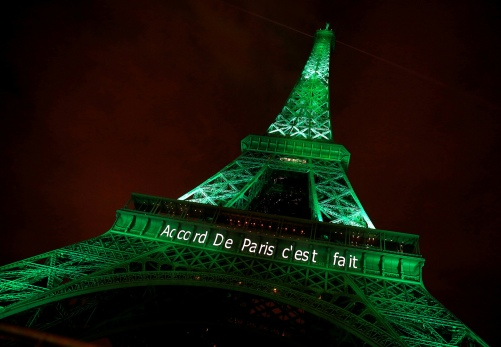 "The Eiffel tower is illuminated in green with the words ""Paris Agreement is Done"", to celebrate the Paris U.N. COP21 Climate Change agreement in Paris"